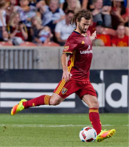Michael Mangum     Special to the Tribune  Real Salt Lake midfielder Kyle Beckerman (5) sends out a pass during their MLS match at Rio Tinto Stadium in Sandy, Utah on Friday, July 22nd, 2016.