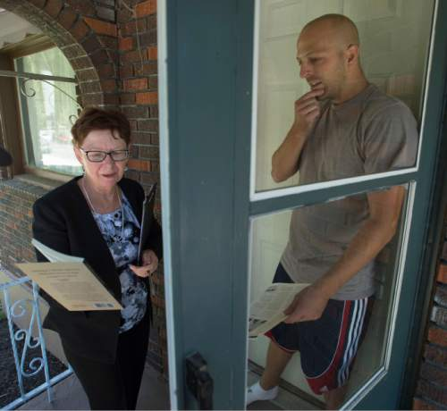 Steve Griffin  |  Tribune file photo Alyson Kennedy, who is running for president on the Socialist Workers Party ticket, talks with Salt Lake City resident Greg Lee as she campaigns door to door near Liberty Park in Salt Lake City earlier this month.