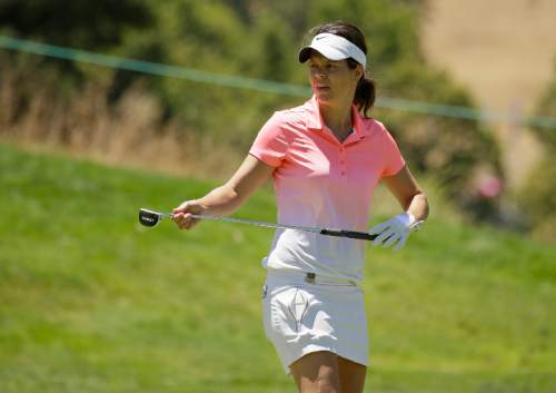 In this Thursday, July 7, 2016 photo, Miriam Nagl, of Brazil, looks over the 10th green during the first round of the U.S. Women's Open golf tournament at CordeValle in San Martin, Calif. Several athletes with limited connections to Brazil will be fulfilling their Olympic dream thanks to Brazil's shortage of athletes in many of the sports in which it automatically qualified for the Rio Games as host despite a lack of Olympic tradition. Some have lived away for most of their lives but were born in Brazil.  (AP Photo/Eric Risberg)