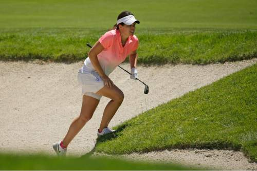 In this Thursday, July 7, 2016, Miriam Nagl, of Brazil, follows her shot out of a bunker on the 10th fairway during the first round of the U.S. Women's Open golf tournament at CordeValle in San Martin, Calif. Many foreigners are taking advantage of Brazil's shortage of athletes in sports in which it automatically qualified for the Rio de Janeiro Games as host despite not having any Olympic tradition. Using the slightest connection to the country, international athletes have found ways to defend the host nation and fulfill their Olympic dream. (AP Photo/Eric Risberg)