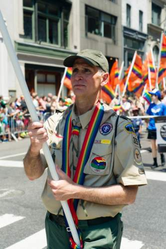 This Sunday, June 26, 2016 photo provided by Brian Gorman shows Greg Bourke from Louisville, Ky., marching in the gay pride parade in New York. Bourke went public with details of how the Archdiocese of Louisville refused to reinstate him as a leader of a Catholic-sponsored Scout troop despite the Boy Scouts of America National Executive Board's decision to end a long-standing blanket ban on participation by openly gay adults. (Brian Gorman via AP)