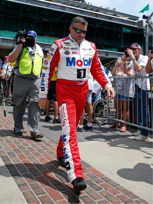 Tony Stewart  walks out on the yard of bricks during driver introductions before the Brickyard 400 NASCAR Sprint Cup auto race at Indianapolis Motor Speedway in Indianapolis, Sunday, July 24, 2016. (AP Photo/Rob Baker)