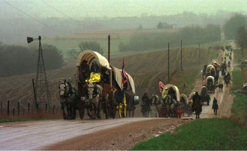 Rick Egan  |  Tribune file photo  A wagon train makes its way through the countryside during a pioneer reenactment in 1997.