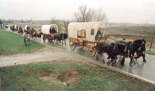 Rick Egan     Tribune file photo  A wagon train makes travels through rural Nebraska during a pioneer reenactment in 1997.
