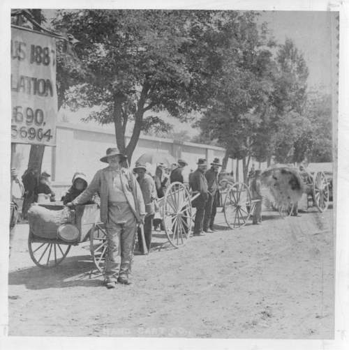 Tribune file photo  A parade of handcarts is seen in this 1887 photo.