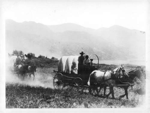 Tribune file photo  This 1936 photo shows a participants in a Mormon Pioneer wagon train reenactment.