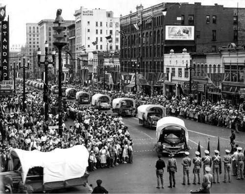 Tribune file photo  Cars decorated as covered wagons take part in the 1947 Pioneer Day parade.