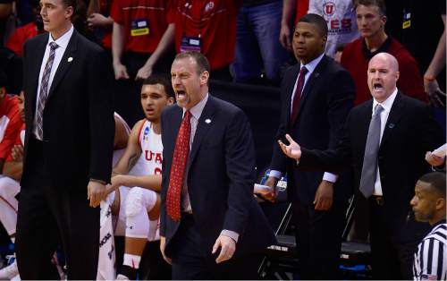 Scott Sommerdorf   |  The Salt Lake Tribune   Utah head coach Larry Krystkowiak and assistants yell at officials questioning a call during first half play. Gonzaga held a 44-29 lead over Utah at the half, Saturday, March 19, 2016.