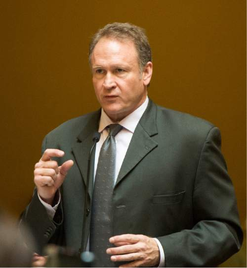 Rick Egan  |  The Salt Lake Tribune  Senator Mark Madsen R-Saratoga Springs, sponsor of the medical marijuana bill SB73 discusses his bill on the floor of the senate Friday, February 19, 2016.