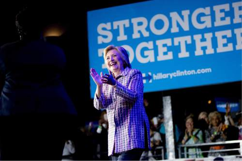 Democratic presidential candidate Hillary Clinton arrives to speak to volunteers at a Democratic party organizing event at the Neighborhood Theatre in Charlotte, N.C., Monday, July 25, 2016. (AP Photo/Andrew Harnik)
