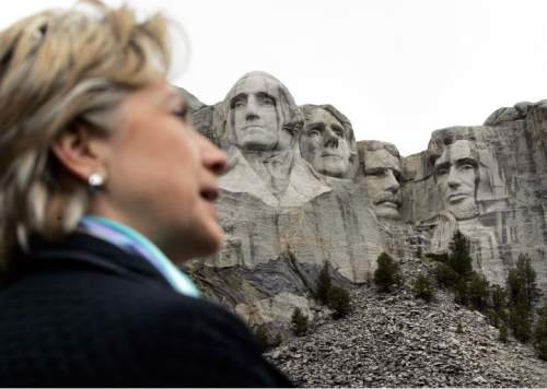 FILE - In this Wednesday, May 28, 2008 file photo, Democratic presidential hopeful Sen. Hillary Clinton, D-N.Y., visits the presidential sculptures at Mount Rushmore near Keystone, S.D., as she campaigns in South Dakota. (AP Photo/Elise Amendola)