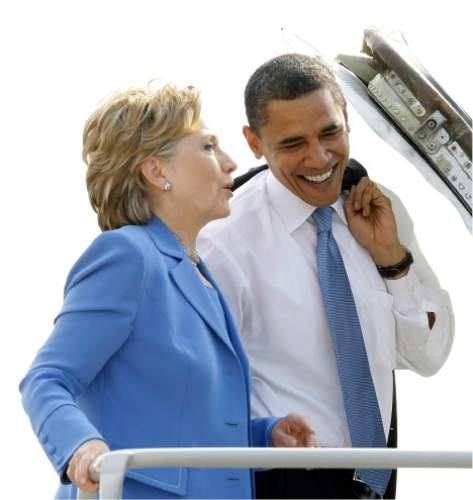 FILE - In this Friday, June 27, 2008 file photo, Democratic presidential candidate Sen. Barack Obama, D-Ill., boards a plane with Sen. Hillary Clinton, D-N.Y., at Washington's Ronald Reagan National Airport. (AP Photo/Alex Brandon)