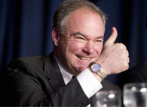 FILE - In this Feb. 4, 2016, file photo, Sen. Tim Kaine, D-Va., gives a 'thumbs-up' as he takes his seat at the head table for the National Prayer Breakfast in Washington.  (AP Photo/Pablo Martinez Monsivais, File)