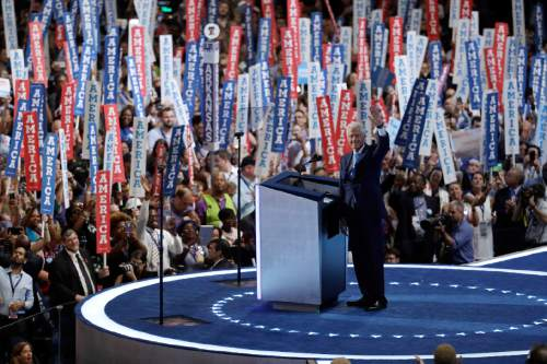 Former President Bill Clinton waves as he takes the stage during the second day session of the Democratic National Convention in Philadelphia, Tuesday, July 26, 2016. (AP Photo/John Locher)