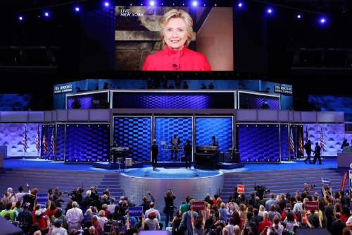 Democratic Presidential candidate Hillary Clinton appears on a large monitor to thank delegates during the second day of the Democratic National Convention in Philadelphia , Tuesday, July 26, 2016. (AP Photo/J. Scott Applewhite)