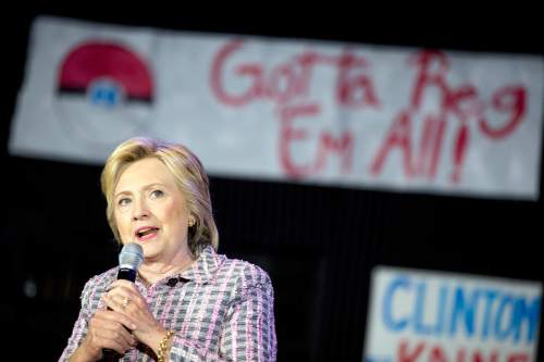 A Pokemon poster is visible behind Democratic presidential candidate Hillary Clinton as she speaks to volunteers at a Democratic party organizing event at the Neighborhood Theater in Charlotte, N.C., Monday, July 25, 2016. (AP Photo/Andrew Harnik)