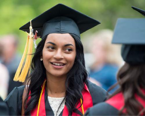 Rick Egan  |  Tribune file photo  Nisha Kavalam visits with University of Utah classmates as she prepares for her May 2016 graduation ceremony in the College of Social Work at Kingsbury Hall. Kavalam says administrators mishandled a sexual assault investigation after she reported being raped by a classmate.