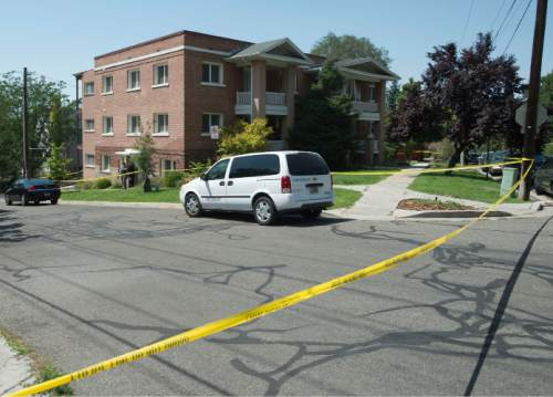 Steve Griffin  |  The Salt Lake Tribune  Police investigate the deaths of two people at apartment complex neart 600 North Center Street in Salt Lake City on Tuesday July 26, 2016.