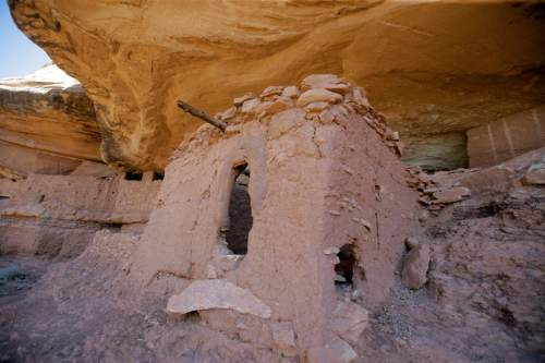 """The """"Moonhouse"""" in McLoyd Canyon is shown during U.S. Interior Secretary Sally Jewell tour Friday, July 15, 2016, near Blanding, Utah. Jewell is touring archaeological sites in southeast Utah that a coalition of American Indian tribes and environmental groups want to see protected as a new national monument. Jewell hiked out to nearby ancient cliff dwellings as part of a research trip to hear from those who support and oppose creating a monument in the Bears Ears area. (AP Photo/Rick Bowmer)"""