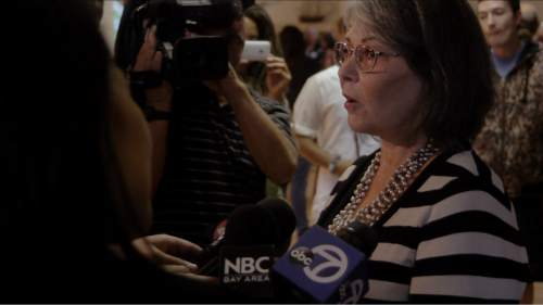 """Roseanne Barr talks to the press while campaigning as a third-party presidential candidate in 2012, in a scene from the documentary """"Roseanne For President!"""" Courtesy Sundance Selects/IFC Films"""
