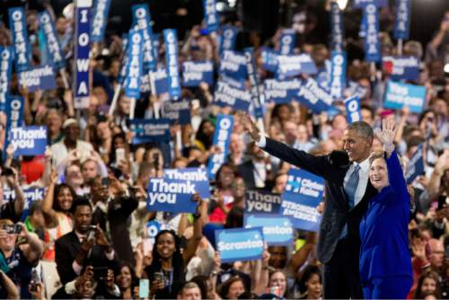 President Barack Obama and Democratic presidential candidate Hillary Clinton wave as they appear on stage together on the third day session of the Democratic National Convention in Philadelphia, Wednesday, July 27, 2016. (AP Photo/Andrew Harnik)