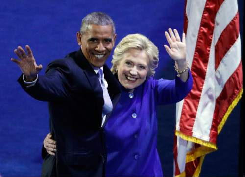 President Barack Obama and Democratic presidential candidate Hillary Clinton wave to the crowd during the third day of the Democratic National Convention, Wednesday, July 27, 2016, in Philadelphia. (AP Photo/John Locher)