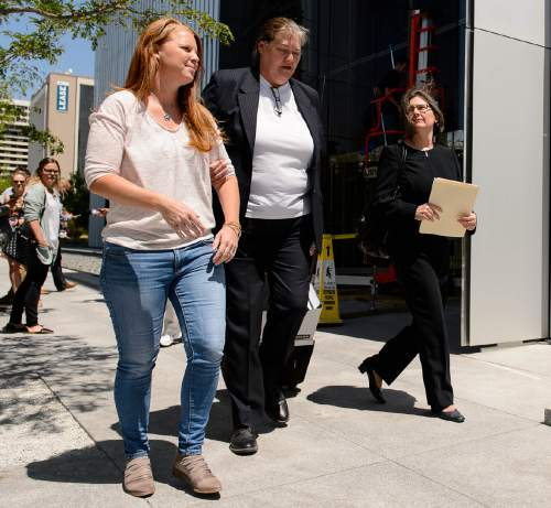 Trent Nelson  |  The Salt Lake Tribune Sharla Johnson, left, outside the federal courthouse in Salt Lake City after a federal judge sentenced her husband, online entrepreneur Jeremy Johnson, to 135 months in prison for eight counts of making false statements to a bank. Friday July 29, 2016.