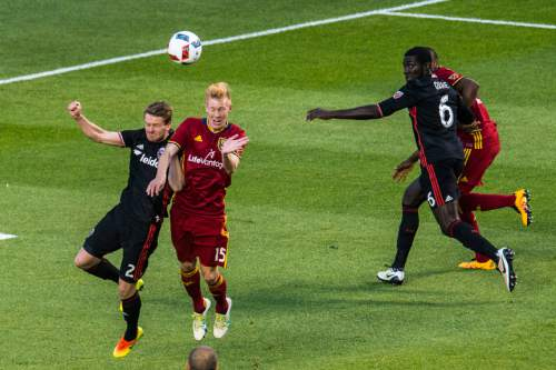 Chris Detrick  |  The Salt Lake Tribune D.C. United defender Taylor Kemp (2) and Real Salt Lake defender Justen Glad (15) go for the ball during the game at Rio Tinto Stadium Friday July 1, 2016.