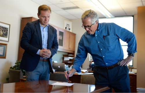 Francisco Kjolseth   Tribune file photo The Salt Lake Tribune's new owner, Paul Huntsman, visits the offices to wrap up the final details Tuesday, May 31, 2016, as he speaks with then-Editor Terry Orme. Huntsman recently replaced Orme with former reporter Jennifer Napier-Pearce.