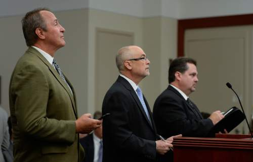 Francisco Kjolseth | The Salt Lake Tribune Former Utah Attorney General Mark Shurtleff, left, facing public corruption charges, appears in Judge Elizabeth Hruby-Mills courtroom alongside his attorney Richard Van Wagoner, center, in Salt Lake City on Monday, Sept. 28, 2015, for a pre-trial hearing. At right is Davis County prosecutor Troy Rawlings.
