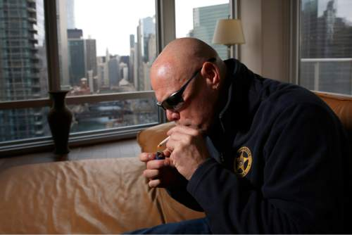 "In this Jan. 28, 2016 photo, former Chicago Bears quarterback Jim McMahons smokes medical marijuana in Chicago. McMahon calls himself ""old school,"" including his use of marijuana both during and after his career. Yet McMahon's stab at self-medicating could turn out to be ahead of its time. If a compound found in hemp _ and its notorious cousin, cannabis _ proves as effective in treating brain injuries as testimonials claim, it would also be welcome news for the NFL on concussions, and even better for players. (Jose M. Osorio/Chicago Tribune via AP)"