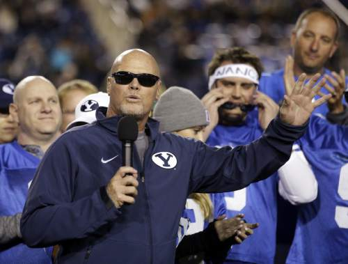 "FILE - In this Oct. 3, 2014, file photo, former BYU and Chicago Bears quarterback Jim McMahon speaks as his No. 9 jersey went on permanent display at LaVell Edwards Stadium, during BYU's NCAA college football game against Utah State in Provo, Utah. McMahon calls himself ""old school,"" including his use of marijuana both during and after his career. (AP Photo/Rick Bowmer, File)"