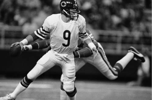 Chicago Bears' Jim McMahon (9) is shown during action against the Minnesota Vikings in Minnesota, Nov. 28, 1982.  (AP Photo/Jim Mone)