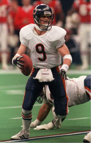 Chicago Bears quarterback Jim McMahon eludes New England Patriots defenders during Super Bowl XX in New Orleans, Jan. 26, 1986. McMahon is walking away from the NFL with no other plans than to spend time with his family and play golf. ``I'm retiring,'' McMahon, 37, told The Chicago Tribune on Wednesday, March 19, 1997. (AP Photo/Ray Stubblebine)