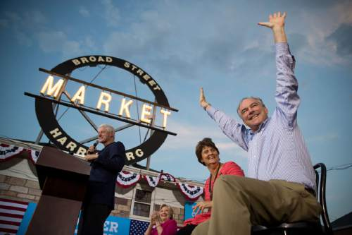 Democratic vice presidential candidate, Sen. Tim Kaine, D-Va., right, reacts as he is introduced by former President Bill Clinton, left, as he sits on stage with Democratic presidential candidate Hillary Clinton, second from left, and Tim Kaine's wife Anne Holton, second from right, visit Broad Street Market in Harrisburg, Pa., Friday, July 29, 2016. Clinton and Kaine begin a three day bus tour through the rust belt. (AP Photo/Andrew Harnik)