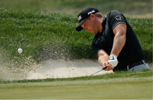 Daniel Summerhays hits from a sand trap on the first hole during the third round of the PGA Championship golf tournament at Baltusrol Golf Club in Springfield, N.J., Saturday, July 30, 2016. (AP Photo/Mike Groll)