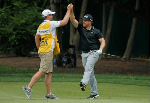 Daniel Summerhays, right, celebrates with his caddie Nick Jones, left, after making an eagle on the second hole during the third round of the PGA Championship golf tournament at Baltusrol Golf Club in Springfield, N.J., Saturday, July 30, 2016. (AP Photo/Tony Gutierrez)