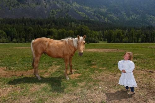 Trent Nelson  |  The Salt Lake Tribune Maraya Blackmore, one of Winston Blackmore's daughters, poses near a horse in Bountiful, British Columbia, 2006.