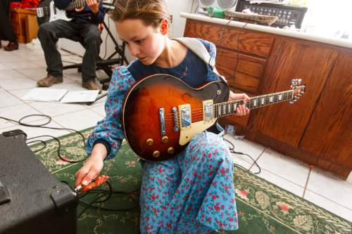 Trent Nelson  |  The Salt Lake Tribune Sally Blackmore plugs in her electric guitar before a jam session in Bountiful, British Columbia, 2006.