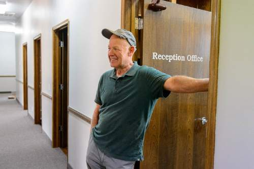 Trent Nelson  |  The Salt Lake Tribune Dr. Keith Leonard takes a break from working on a new dental office to serve patients in Hildale, Monday July 4, 2016. The building had been empty for years after the previous dentist, a member of the FLDS church, closed the office.