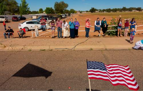 Trent Nelson  |  The Salt Lake Tribune Onlookers in a variety of dress line the sidewalk for the Colorado City and Hildale Fourth of July Parade in Hildale, UT, as part of an Independence Day celebration Saturday July 2, 2016.