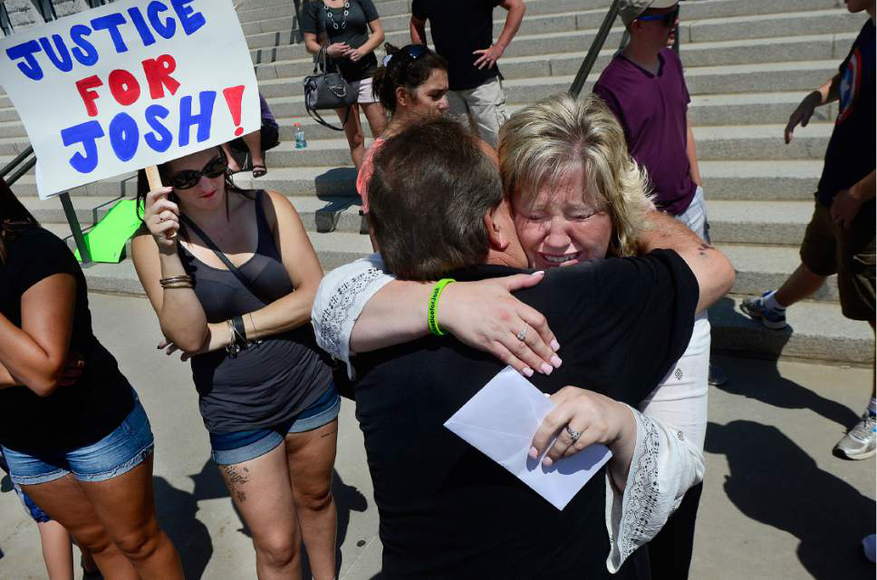Scott Sommerdorf      The Salt Lake Tribune   Josh Holt's mother Laurie Holt hugs her uncle Leonard Bell after a rally on the east steps of the Utah State Capitol that called for the release of their 24-year-old son Josh Holt, who is currently jailed in Venezuela on Saturday.