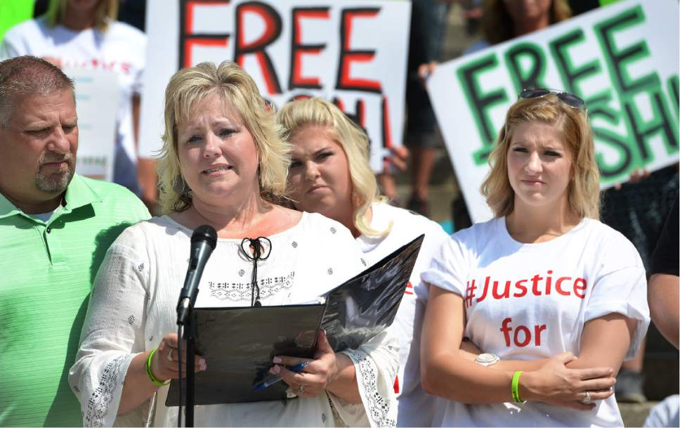 Scott Sommerdorf      The Salt Lake Tribune   Laurie Holt, Josh Holt's mother speaks at a rally on the east steps of the Utah State Capitol in July calling for the release of her 24-year-old son Josh Holt, who is currently jailed in Venezuela. At left is her husband Jason Holt, with Josh's sisters Katie, and Jenna Holt, far right.