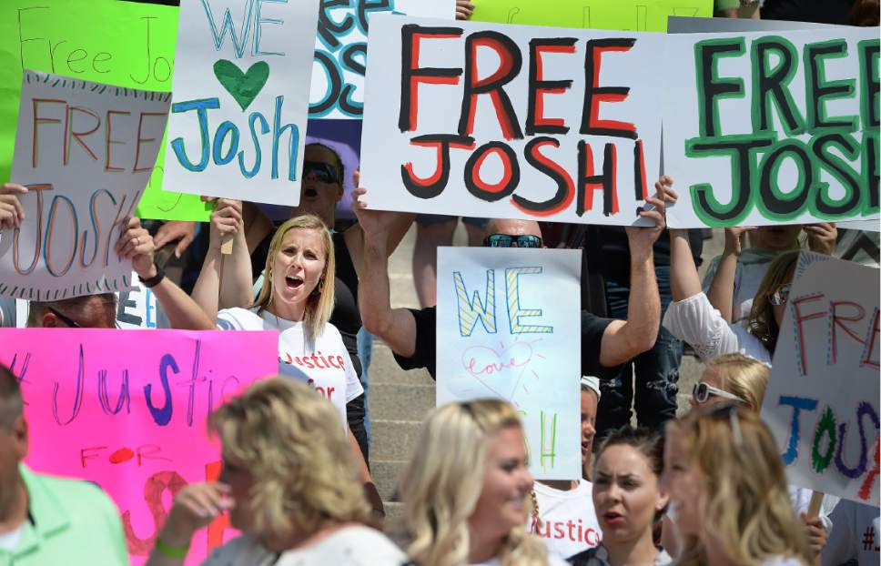 """Scott Sommerdorf      The Salt Lake Tribune   A crowd of friends and family shout """"Bring Home Josh!"""" at the end of a rally on the east steps of the Utah State Capitol for 24-year-old Josh Holt, who is currently jailed in Venezuela, Saturday, July 30, 2016."""