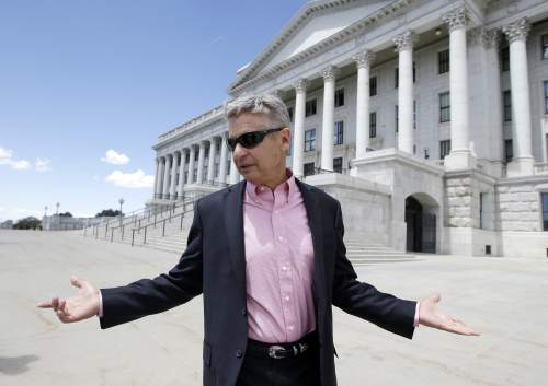 """FILE - In this May 18, 2016 file photo, Libertarian presidential candidate, former New Mexico Gov. Gary Johnson leaves the Utah State Capitol after meeting with with legislators, in Salt Lake City. He has virtually no money, no strategy to compete in battleground states and no plan to stop talking about his drug use. Yet with the Republican Party facing the prospect of a Donald Trump presidency, Libertarian presidential hopeful Gary Johnson could be a factor in 2016. The former two-term New Mexico governor, a Republican businessman perhaps best known for his years-long push to legalize marijuana, has a sobering message for a """"never-Trump"""" movement desperately seeking a viable alternative. (AP Photo/Rick Bowmer, File)"""