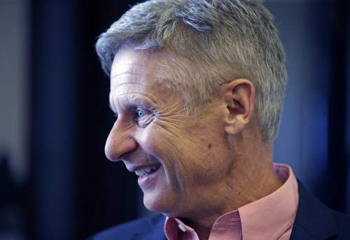 """FILE - In this May 18, 2016 file photo, Libertarian presidential candidate, former New Mexico Gov. Gary Johnson speak with legislators at the Utah State Capitol in Salt Lake City. He has virtually no money, no strategy to compete in battleground states and no plan to stop talking about his drug use. Yet with the Republican Party facing the prospect of a Donald Trump presidency, Libertarian presidential hopeful Gary Johnson could be a factor in 2016. The former two-term New Mexico governor, a Republican businessman perhaps best known for his years-long push to legalize marijuana, has a sobering message for a """"never-Trump"""" movement desperately seeking a viable alternative. (AP Photo/Rick Bowmer, File)"""