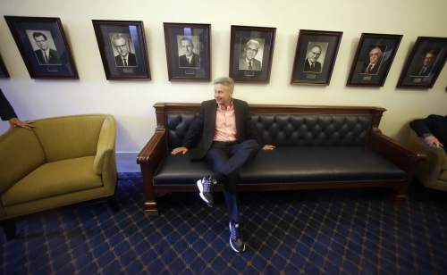 """FILE - In this May 18, 2016 file photo, Libertarian presidential candidate, former New Mexico Gov. Gary Johnson waits to speak with legislators at the Utah State Capitol in Salt Lake City. He has virtually no money, no strategy to compete in battleground states and no plan to stop talking about his drug use. Yet with the Republican Party facing the prospect of a Donald Trump presidency, Libertarian presidential hopeful Gary Johnson could be a factor in 2016. The former two-term New Mexico governor, a Republican businessman perhaps best known for his years-long push to legalize marijuana, has a sobering message for a """"never-Trump"""" movement desperately seeking a viable alternative. (AP Photo/Rick Bowmer, File)"""
