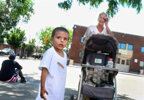 Scott Sommerdorf   |   Tribune  file photo Kathy Maestas is homeless along with her 3-year-old grandson, Navin, on Rio Grande Street near the Salt Lake Road Home, Friday, July 8, 2016.