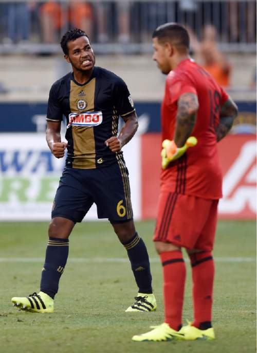 Philadelphia Union's Roland Alberg (6) celebrates in front of Real Salt Lake goalie Nick Rimando after scoring on a penalty kick during the first half of an MLS soccer match on Sunday, July 31, 2016, in Chester, Pa. (AP Photo/Michael Perez)