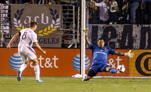 Real Salt Lake goalkeeper Nick Rimando, right, tries to save goal by Los Angeles Galaxy midfielder Steven Gerrard during the second half of an MLS soccer game in Carson, Calif., Saturday, April 23, 2016. The Galaxy won 5-2. (AP Photo/Ringo H.W. Chiu)
